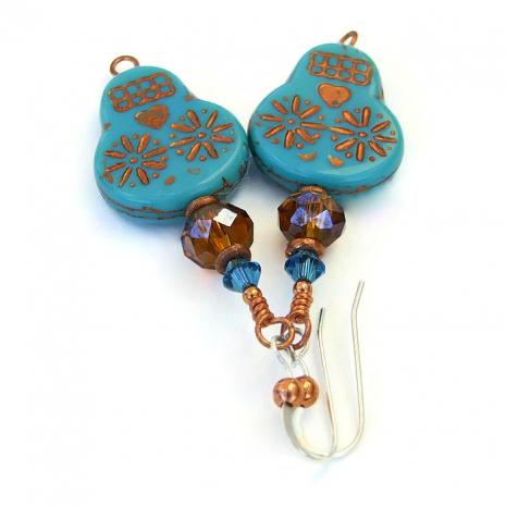 Halloween skull earrings.