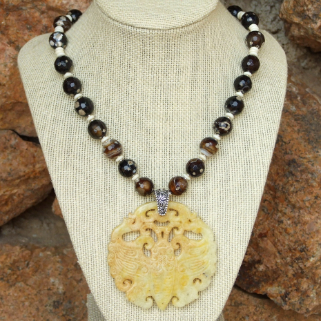 carved jade moth necklace with speckled fire agate