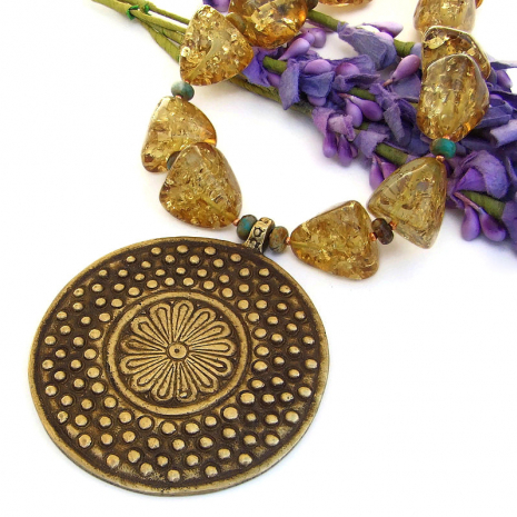 vintage brass african flower pendant necklace with amber and turquoise