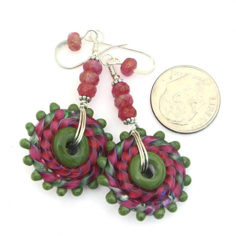 Pink and green whirling lampwork earrings.