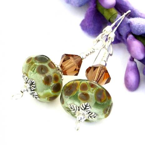 Green and brown raku handmade lampwork earrings.