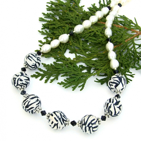 Black and white zebra patterned polymer clay bead necklace with pearls.