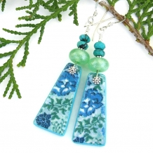 Blue flower earrings.