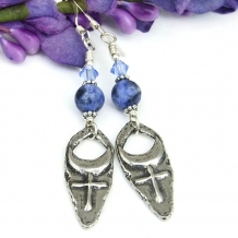 Cross and moon earrings.