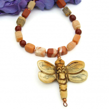 Unique handmade necklace featuring a carved bone dragonfly pendant and jasper.