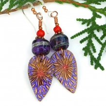 Purple and red earrings.