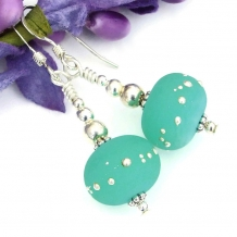 Mint green kryptonite lampwork earrings.