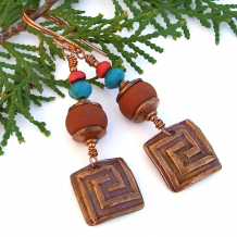 Unique copper labyrinth and terracotta lampwork earrings.