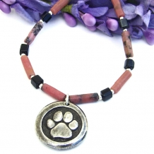 Dog paw print and St francis necklace.