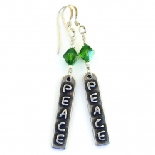 Peace word earrings.