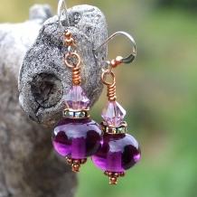 Purple earrings.