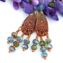 One of a kind handmade peacock feather chandelier earrings.