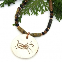 Running horse necklace with gemstones.