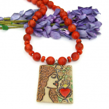 sacred heart pendant and red orange sponge coral necklace
