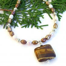 One of a kind petrified wood pendant and pearls handmade necklace.