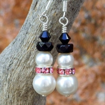 Handmade breast cancer survivor snowmen earrings with pink.