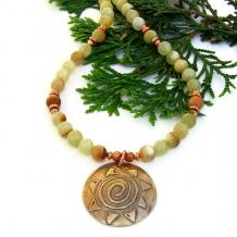 spiral sun bronze pendant and striped honey onyx gemstone necklace