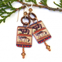 sumatran rhinoceros black backed jackal earrings with crystals