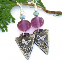Butterfly charm and purple amethyst lampwork handmade earrings.