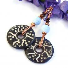 Unique handmade boho earrings feature hand carved bone discs